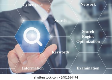 man touching magnifier search button