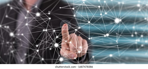 Man touching a network on a touch screen with his finger