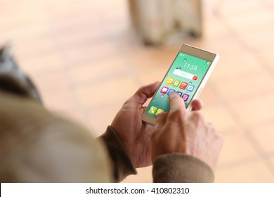 man touching the screen of his smartphone. All screen graphics are made up.