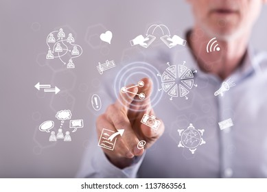 Man touching share symbols on a touch screen with his finger