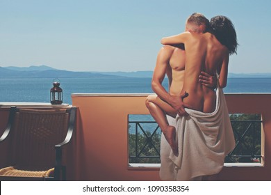 Man touching softly woman's body in black lingerie during sensual foreplay. Sensual couple. Sexy man and woman. Hot guy. Adult. Passionate. Sexy ertoic game play. Summer time. Vacation. Luxury hotel.