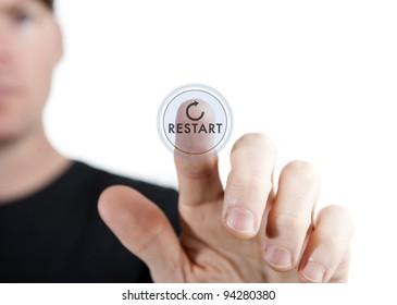 man touching a virtual restart button