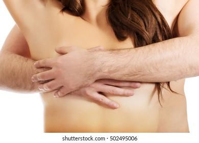 Man touching woman's breast.