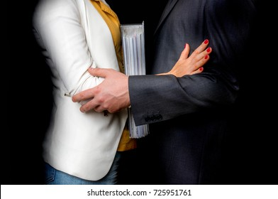 Man touching woman's elbow isolated on black - sexual harassment in business office