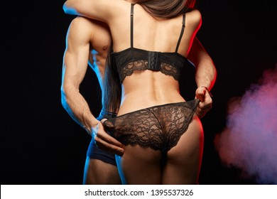 Man touching woman's lace underwear. foreplay concept. close up cropped back view photo.