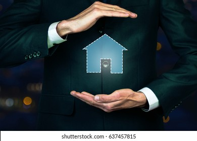 Man with touchscreen sign house network icon