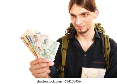 Man tourist backpacker holding euro money and map. Young guy hiker backpacking. Summer vacation travel. Isolated on white background.
