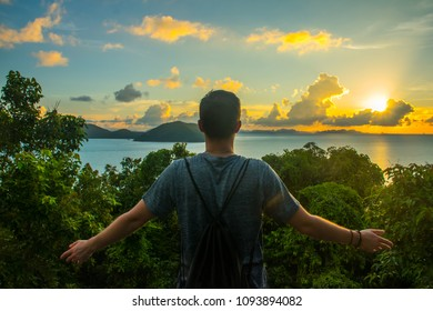 Man tourist are looking at the beautiful natural landscape of the sea on peak view point of Koh Samui Island, Surat Thani, Thailand