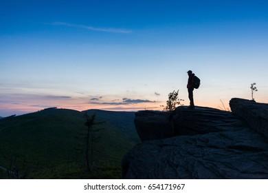 Man tourist standing on top of hill. Malinowska Skala. Szczyrk. Silesian Beskid, Poland