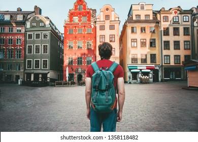 Man tourist walking in Stockholm travel sightseeing Gamla Stan Stortorget architecture lifestyle summer trip vacations in Sweden