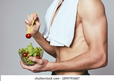 a man with a towel on his shoulders a plate of salad healthy food diet