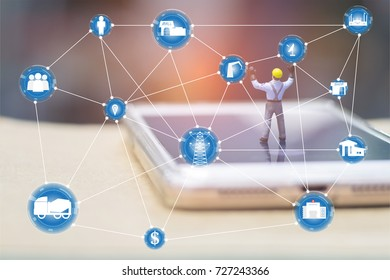 A man is toy model standing  on phone and show two hands in concept technology, network, industry.