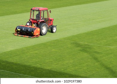 Man in tractor aerating a soccer field