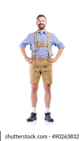 Man in traditional bavarian clothes, hands on hips