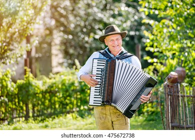 Man in traditional bavarian clothes playing the accordion