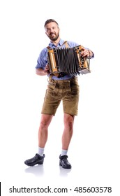 Man in traditional bavarian clothes playing accordion. Oktoberfe