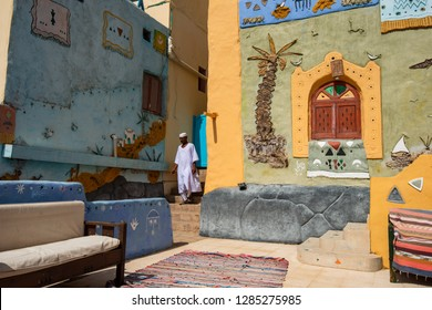 A man in traditional clothes stands in front of a Nubian-style house, Aswan, southern Egypt August 12, 2015,