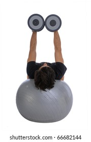 Man training with dumbbells, lying horizontally balanced over a fitball