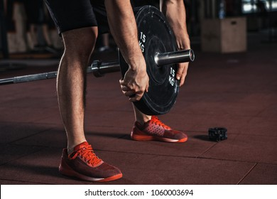 Man with training equipment in sport gym. Crossfit training.