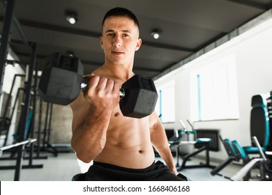 the man is training in the gym