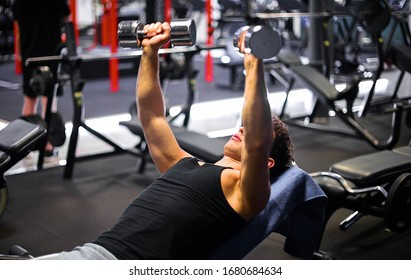 Man training his chest in the gym