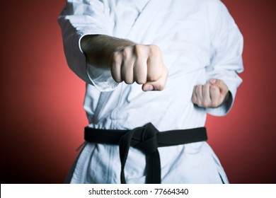 Man training karate at gym, sport and fitness concept