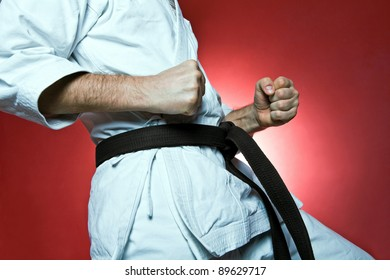 Man training karate over red background