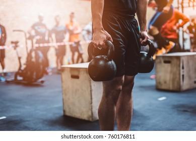 Man training with kettlebell in functional fitness gym. Kettlebell deadlift