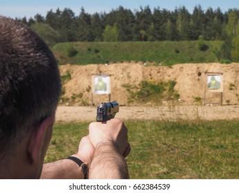 Man trains shooting at open shooting range