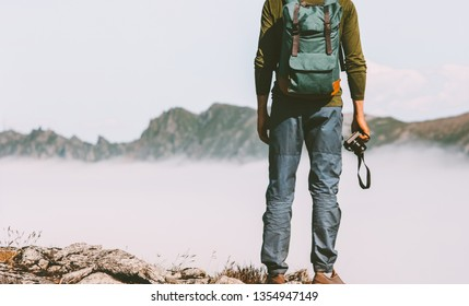 Man travel photographer with photo camera in mountains extreme blogger lifestyle hobby concept adventure summer trip outdoor