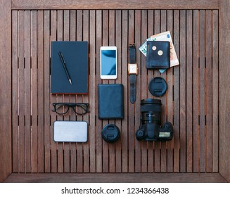 Man travel set and accessories on a wooden background. Top view