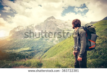 0cb76de1dff9 Man Traveler with backpack hiking Travel Lifestyle concept mountains on background  Summer journey adventure vacations outdoor
