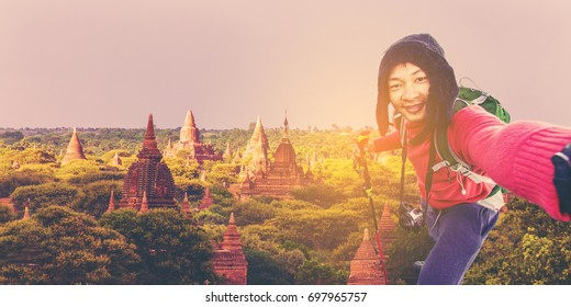 Man Traveler with backpack mountaineering Travel Lifestyle concept lake and mountains on background view at The Temples of Bagan (Pagan), Mandalay, Myanmar. BURMA.