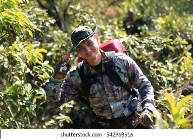 Man Traveler with backpack trekking in forest, Hikers trekking  with backpacks in forest