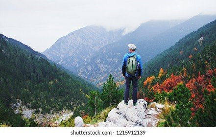 Man traveler hiking in mountains. Adventure solo traveling lifestyle. Wanderlust adventure concept. Active weekend vacations wild nature outdoor. Mount Olympus, Greece, europe, autumn fall, october.