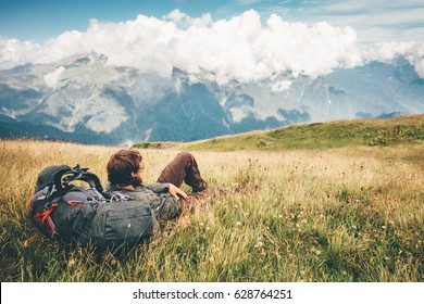 Man Traveler relaxing laying enjoying mountains landscape Travel Lifestyle hiking concept adventure summer vacations outdoor