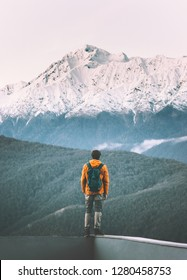 Man traveler standing alone enjoying mountains view active adventure lifestyle vacations travel outdoor solitude and silence