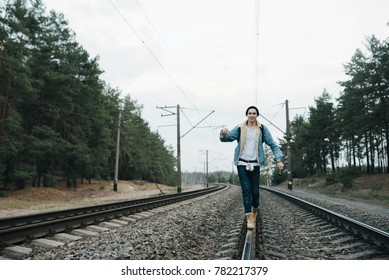 Man traveler traveling walking with backpack at the railway on holiday weekend on background nature view