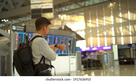 Man traveler waiting in terminal airport