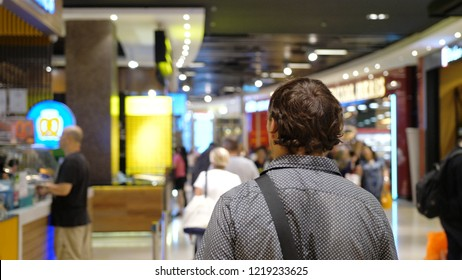 Man traveler walkes in shapping mall