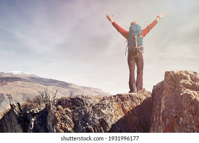 Man traveling with backpack hiking in mountains Travel Lifestyle success concept adventure active vacations outdoor mountaineering sport.