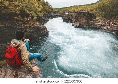 Man traveling relaxing alone with river canyon view adventure lifestyle hiking adventure vacations outdoor exploring Sweden