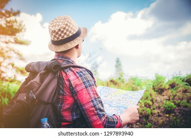 Man traveling tourist backpackers enjoying scenery nature view while hiking in National Park. of hikers planning next way to explore holding map during travel. Infographics illustration map with top d