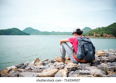 man traveling walking with backpack at national park in the jungle day time sun shine on holiday at weekend relax fresh on background nature view