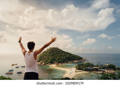 A man Traveller  at viewpoint on island,Travel Vacation Lifestyle summer Concept.Tropical paradise on the island of Koh nang yuan in Thailand,vintage tone