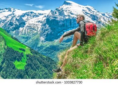 man travels through the Swiss mountainous surroundings, the Engelberg resort, Switzerland