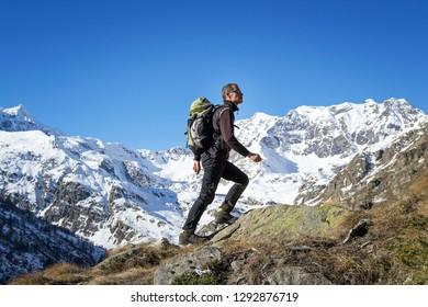 Man trekking in the Alps. Grand Paradiso National Park. Italy