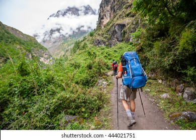 Man is trekking in forest and highlands of Himalayas mountains in Nepal