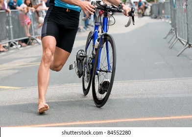 man at triathlon with bicycle