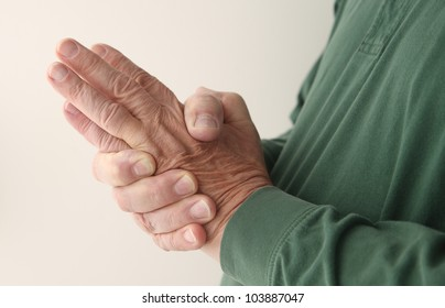 a man tries to massage the numbness out of his hand